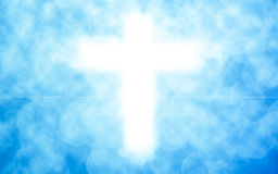 Christian cross with bokeh light background,blue color tone Royalty Free Stock Photos