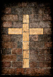 Christian cross in brick wall Stock Photos