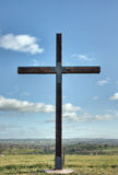 Christian cross of christ in field Royalty Free Stock Photo