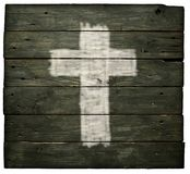 Christian cross. On old wooden planks stock images