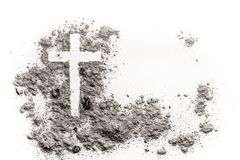 Christian cross or crucifix drawing in ash, dust or sand royalty free stock images