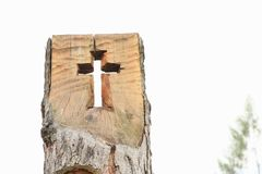 Cross in wooden trunk. Christian cross cut into wooden trunk of birch tree with white bark Royalty Free Stock Photo