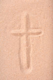 Christian cross drawn in dry sand Stock Photography