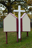Christian Cross at the Entrance of a Protestant Church Royalty Free Stock Photo