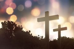 Christian cross on the field. With bokeh background stock images