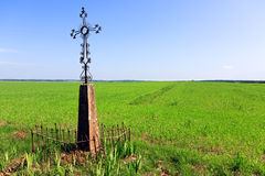 Christian Cross in a field Stock Image