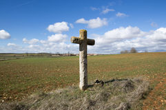 Christian cross in the field Stock Photos