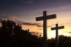 Christian cross in the field with trees. Over sunset sky background stock images