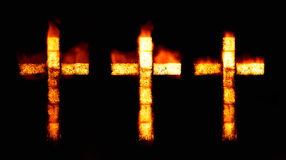 Christian cross on fire Stock Photos