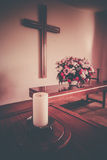 Christian cross and flowers on altar Royalty Free Stock Photo