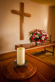 Christian cross and flowers on altar Royalty Free Stock Images