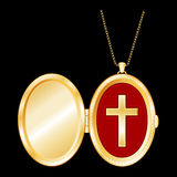 christian cross gold locket 免版税图库摄影