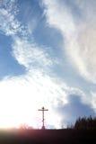 Christian cross on a hill against the sky Royalty Free Stock Photos