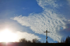 Christian cross on a hill against the sky Stock Photos