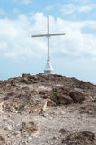 Christian Cross on Hill (3). Cross on Rugged Summit with Blue Sky and Fluffy White Clouds Stock Photo