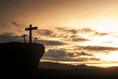 Christian cross on the hill. At sunset background royalty free stock photo
