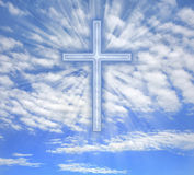 Christian cross with light beams over sky. Christian cross with light beams over blue sky stock illustration