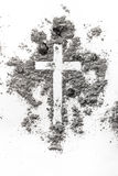 Christian cross made in ash, dust as religion concept background. Christian cross made in ash, dust as a religion, ash wednesday concept background stock images