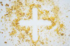 Christian cross made of crumbs. On a gray background royalty free stock photos