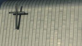 Christian cross. On the modern wall Stock Image