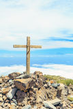 Christian cross on mountain top Stock Photos