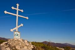 Christian cross in a mountains Stock Images