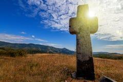 Christian cross on a mountains Stock Photo