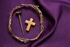 Christian cross, nail and the crown of thorns of Jesus Christ Stock Photography