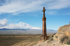 Christian cross near ancient monastery Khor Virap. Christian cross in ancient monastery Khor Virap near Turkish-Armenian border in front of Ararat mountain Royalty Free Stock Images