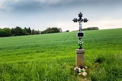 The christian cross near countryside road. In Czech Republic royalty free stock images
