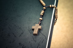 Christian cross necklace on Holy Bible book, Jesus religion conc Stock Photos