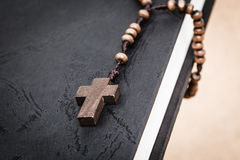 Christian cross necklace on Holy Bible book, Jesus religion conc Royalty Free Stock Photos