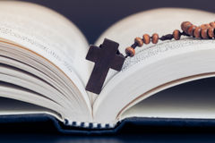 Christian cross necklace on Holy Bible book, Jesus religion conc Royalty Free Stock Photo