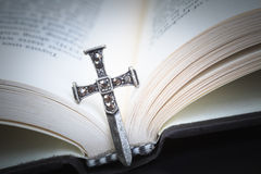Christian cross necklace on Holy Bible book, Jesus religion conc. Ept as good friday or easter festival Royalty Free Stock Image