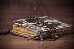 Christian cross necklace and prayer-book Royalty Free Stock Photo