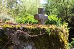 Christian cross on an old stone wall in Normandy, France Royalty Free Stock Image