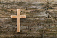 Christian cross old wood on wooden background christianity. Symbol stock photo