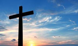Cross over bright sunset background. Christian cross over beautiful sky background concept of religion royalty free stock photography