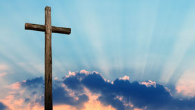 Christian cross over beautiful sky. Christian cross made of wood over beautiful sky background Stock Images