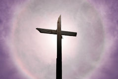 Christian cross over beautiful sunny sky Royalty Free Stock Images