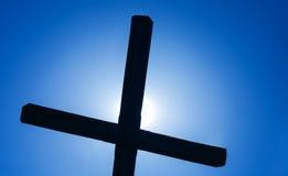 Christian cross over beautiful sunny sky Stock Photos