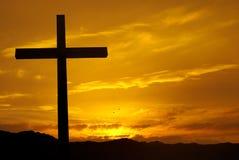 Christian cross over beautiful sunset background Stock Photos