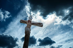 Christian cross over dark stormy sky background Royalty Free Stock Photo