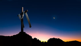 Christian cross over dark sunset background panoramic view Stock Images