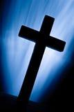 Christian cross over light beans stock image