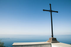 Christian cross over ocean and blue sky Royalty Free Stock Image
