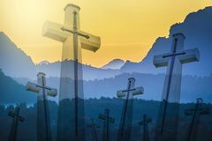 Christian cross with overlapped mountain range. Silhouette style photo with exposure process stock photos