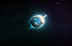 Christian cross on planet earth. Christian cross on planet earth in space stock photography