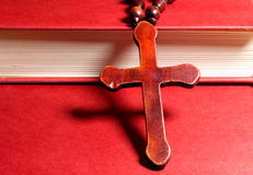 Christian cross on red book Stock Photos