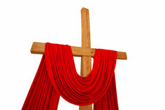 Christian cross with a red cloth isolated on a white background Royalty Free Stock Photography